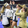 (Brad Davis/The Register-Herald) Shady Spring players celebrate after defeating Robert C. Byrd to advance to the night session during State Volleyball Tournament action Friday afternoon at the Charleston Civic Center.