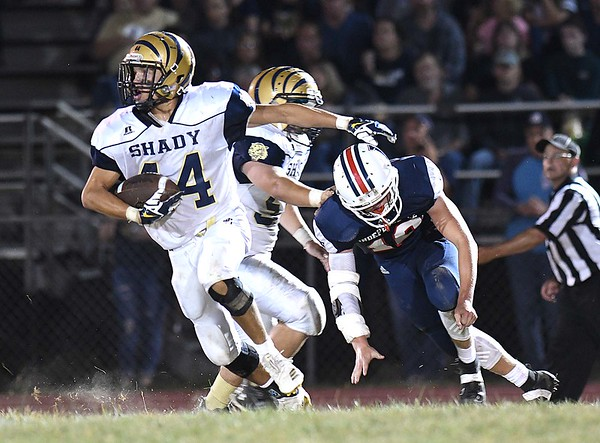 Isaiah Valentine, of Shady Spring, left, breaks away from extra yards against Independence at Independence High School<br /> (Rick Barbero/The Register-Herald)