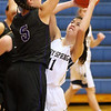 (Brad Davis/The Register-Herald) Shady Spring's #11 drives to the basket as Riverview's Kristen Calhoun defends Friday night in Hinton.