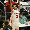 (Brad Davis/The Register-Herald) Oak Hill's Michael Beasley shoots from three-point range as Wyoming East's Evan Preece defends during Big Atlantic Classic action Wednesday night at the Beckley-Raleigh County Convention Center.