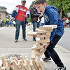 (Brad Davis/The Register-Herald) 12-year-old Flat Top resident Nathanael Wooten reacts as his latest pull from the stack of giant blocks results in collapse as he plays giant jenga at the Sears Monument Company booth during the Appalachian Festival Block Party Saturday evening in downtown Beckley.