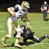 (Brad Davis/The Register-Herald) Shady Spring receiver Haven Chapman picks up yards after making a catch as Liberty defender Jared Baldwin dives for his legs Friday night in Glen Daniel.