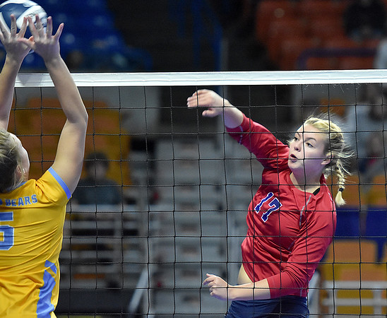 (Brad Davis/The Register-Herald) Independence's Destiny Blankenship spikes the ball as Oak Glen's McKayla Goodlin defends during State Volleyball Tournament action Friday morning at the Charleston Civic Center.