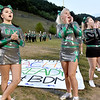 (Brad Davis/The Register-Herald) Wyoming East cheerleaders encourage their home crowd to chant for the Warriors as they wait for them to take the field Friday night in New Richmond.