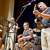 (Brad Davis/The Register-Herald) From right, Brian Bell, Hunter Walker, Lewis Prichard and Barbara Rosner jam appalachian style as Beckley's own Long Point String Band performs the opening set of a night of string music during the Beckley Concert Association's Appalachian Jamboree Thursday night inside the Woodrow Wilson High School Auditorium. Long Point opened the night, the first of six scheduled events this season for BCA, followed by two other performances from Charleston-based Blue Yonder and headliner Mike Mitchell.