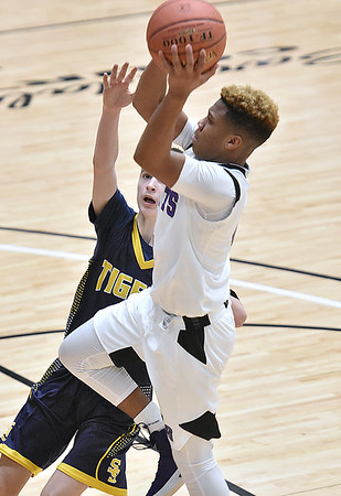(Brad Davis/The Register-Herald) Eastern Greenbrier's Monquelle Davis drives and scores as Shady Spring's Cole Chapman defends during Big Atlantic Classic action Wednesday afternoon at the Beckley-Raleigh County Convention Center.