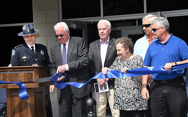 Beckley mayor Rob Rappold, second from left, cuts the ribbon during the dedication ceremony held at the new Beckley Police Department headquarters on 501 Neville Street.<br /> (Rick Barbero/The Register-Herald)