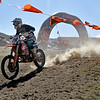 (Brad Davis/The Register-Herald) A rider tears through the start/finish line section as he competes in the Amsoil Grand National Cross Country Racing Series event Sunday afternoon at the Summit Bechtel Reserve.