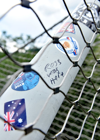 (Brad Davis/The Register-Herald) Small stickers and markings left by scouts from all over the world are left as reminders on the fencing of the Consol Energy Walking Bridge Thursday afternoon at the Summit Bechtel Reserve. By the end of today, just about every scout will be on their ways back home, with some setting off as early as 2:00 a.m.