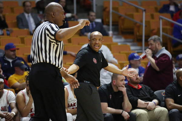 Oak Hill's coach Benitez Jackson yells at the official during their West Virginia State Championship Class AA Quarter Finals in Charleston on Thursday. (Chris Jackson/The Register-Herald)