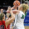 (Brad Davis/The Register-Herald) Wyoming East's Emily Saunders turns to shoot in the paint as Wayne's Sara Hooks defends Friday afternoon in Charleston.