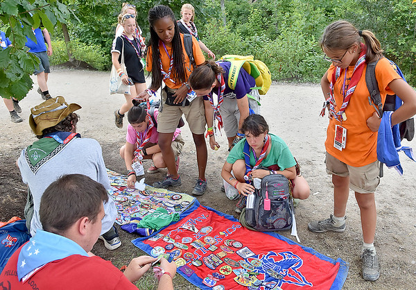 (Brad Davis/The Register-Herald) Scouts negotiate, offer and exchange in a trading area during the last day of World Scout Jamboree activities Thursday afternoon at the Summit Bechtel Reserve. Pop-up trading was a more frequent sight around the Jamboree as the days wound down, with scouts trading items such as neckers, patches, bracelets, flags and anything else unique to their specific countries.