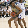 (Brad Davis/The Register-Herald) Oak Hill Academy's Christian Brown drives to the basket as Crestwood Prep's Jo Smith defends during Big Atlantic Classic action Wednesday night at the Beckley-Raleigh County Convention Center