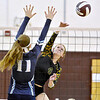 (Brad Davis/The Register-Herald) Greenbrier East's Maggie Thompson spikes the ball as Spring Valley's Caroline Asbury tries to block during Shirley Brown Tournament action Saturday at Woodrow Wilson High School.