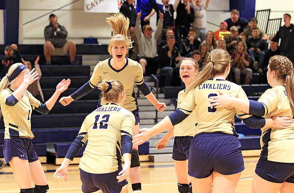 Greenbrier West volleyball players celebrate after winning the Class A Region 3 Section 2 volleyball tournament against Greater Beckley Christian Tuesday at Greenbrier West. (Jenny Harnish/The Register-Herald)