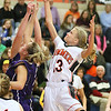 (Brad Davis/The Register-Herald) Summers County's Sullivan Pivont leaps for a rebound with River View's Demi Lester Saturday night in Hinton.
