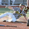 (Brad Davis/The Register-Herald) Miners baserunner Clay Wisner slides and scores a run off a double from teammate Clayton Mehlbauer during the 2nd inning against Terre Haute Saturday evening at Linda K. Epling Stadium.