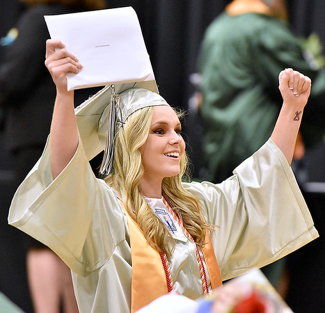 (Brad Davis/The Register-Herald) Wyoming East senior Jasmine Blankenship reacts to friends and family in the stands after collecting her diploma Friday night in New Richmond.