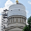 (Brad Davis/The Register-Herald) The capitol's usual gleaming gold dome is obscured by scaffolding and other covering as work continues on a $13 million repair and restoration project Wednesday afternoon in Charleston.