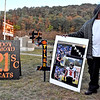 (Brad Davis/The Register-Herald) Carlos Crawford, father of Summers County player Markis Crawford, adds his poster to a collection of other families' displays celebrating their players outside of Garten Stadium prior to the Bobcats' homecoming game against visiting Independence Friday night in Hinton.