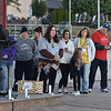 (Brad Davis/The Register-Herald) Family members affected by suicide, from surviving siblings and parents to sons and daughters, gather for the honor bead ceremony Saturday evening at the Walk to Fight Suicide.