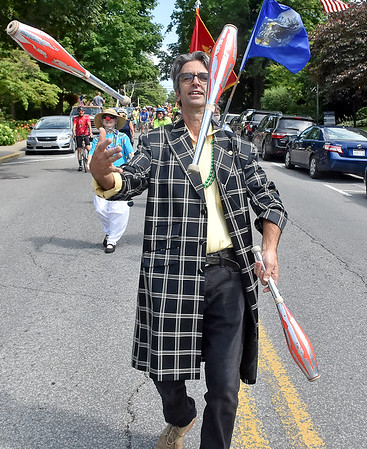 (Brad Davis/The Register-Herald) Glenn Singer juggles as he, friends, family and community members take part in a special parade honoring the life of Chally Erb, kicking off a night of memorials Saturday afternoon in Lewisburg. The Mardi Gras-style parade was a moving monument to his life as a veteran, family man, performer and athlete.