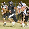 (Brad Davis/The Register-Herald) Liberty's Ryan Simms races past Summers County defenders Markis Crawford (#8), Nicholas Willey (#65) and Sam Wheeler (#6) as he returns a kick Friday night in Glen Daniel.