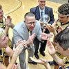 (Brad Davis/The Register-Herald) Shady Spring head coach Ronnie Olson addresses his player after the Tigers defeated Woodrow Wilson for the first time in history to win the Burger King Division Championship Saturday night at the Little General Battle for the Armory.