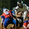 Liberty running back, Issac Atkins, attempts to cut right and avoid a tackle from a Midland Trail defender. Chad Foreman for the Register-Herald.
