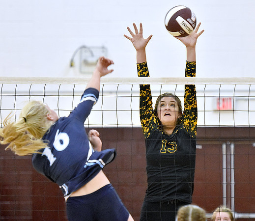 (Brad Davis/The Register-Herald) Greenbrier East's Taylor Dunbar tries to block the ball as Spring Valley's Kennedy Stanley spikes it during Shirley Brown Tournament action Saturday at Woodrow Wilson High School.