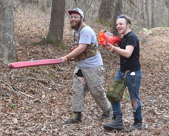 (Brad Davis/The Register-Herald) Combatants Morgan Hilton (left), 17, and Cyrus Hilton, 14, advance on their opponents during a Nerf War at Lake Stephens Saturday afternoon. The free event, another in a line of fun, physical activities presented by Active Southern West Virginia, pits two teams of warriors against each other in capture the flag-style games, using the famous foam armaments of all types, from guns and pistols to axes, swords and shields, all provided by ASWV. Keep an eye on their Facebook page and website for upcoming events including more Nerf Wars, which have been a huge hit so far.