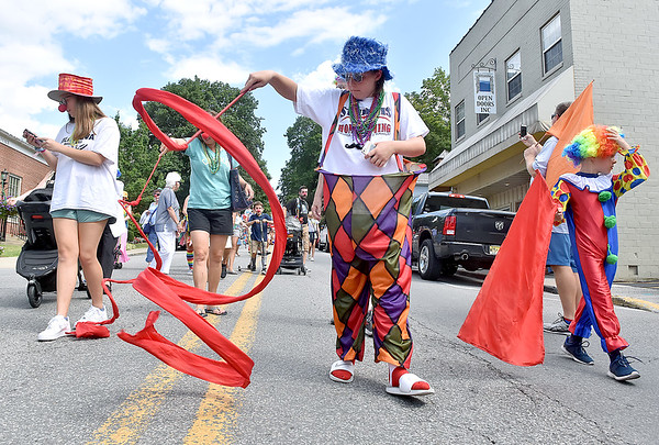 (Brad Davis/The Register-Herald) Friends, acquaintences, family and community members take part in a special parade honoring the life of Chally Erb, kicking off a night of memorials Saturday afternoon in Lewisburg. The Mardi Gras-style parade was a moving monument to his life as a veteran, family man, performer and athlete.