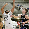 (Brad Davis/The Register-Herald) Greater Beckley Christian's Isaiah Hairston drives to the basket as Princeton's Ethan Parsons defends during Friday action at the Little General Battle for the Armory.