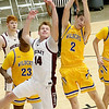 (Brad Davis/The Register-Herald) Woodrow Wilson's Maddex McMillion leaps for a rebound with Logan's Noah Cook during Friday action at the Little General Battle for the Armory.