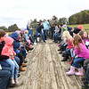 Pineville Elementary School children and parents riding on a tractor at the Okes Family Farm in Cool Ridge.<br /> (Rick Barbero/The Register-Herald)