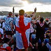 (Brad Davis/The Register-Herald) Scouts sing along to the music as festivities get underway at the World Scout Jamboree's Cultural Celebration Friday night at the Bechtel Summit Reserve.