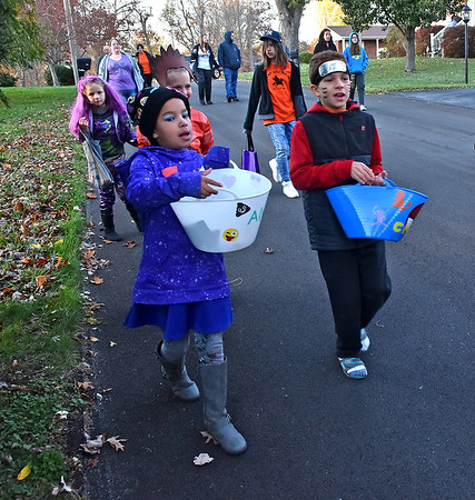 (Brad Davis/The Register-Herald) Trick or treaters on the move in search of candy in the Crescent Road area Saturday evening.