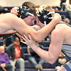 (Brad Davis/The Register-Herald) Independence's J.D. Cernuto, right, takes on Martinsburg's Isaiah Salinas in a 170-pound weight class matchup during the Appalachian Fasteners Invitiational Saturday afternoon in Shady Spring. Martinsburg's Salinas won the match.