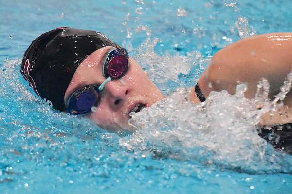 Woodrow Wilson's Savannah Hughes competes in the 200 Meter Freestyle during a tri-meet swim competition in Beckley on Monday. (Chris Jackson/The Register-Herald)
