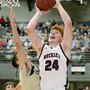 (Brad Davis/The Register-Herald) Woodrow Wilson's Ben Gilliam drives and scores as Shady Spring's Tommy Williams defends Saturday night at the Little General Battle for the Armory.