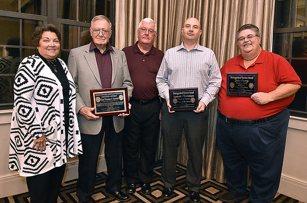 (Brad Davis/The Register-Herald) From left, Becky Durrett, husband and former Beckley Police Department Chief Thomas C. Durrett, retired Lt. Frank Pack, current chief Lonnie Christian and Tim Berry, holding the plaque on behalf of absent award recipient and Deputy Chief Jake Corey, pose for a quick photo at the conclusion of the first Beckley Police Alumni Association Dinner Saturday night at Black Knight Country Club. Durrett received the Legend Award while Christian and Corey received Distinguished Service Awards.