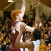 (Brad Davis/The Register-Herald) Woodrow Wilson's Ben Gilliam drives to the basket as Greenbrier East's Quentin Wilson defends Friday night in Fairlea.