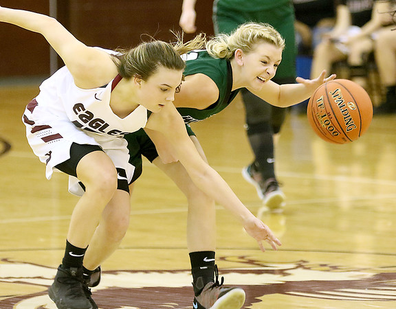 (Brad Davis/The Register-Herald) Wyoming East's Skylar Davidson manages to hold off Woodrow Wilson defender Cloey Frantz as she crashes in for a steal attempt at mid court Saturday night in Beckley.
