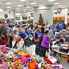(Brad Davis/The Register-Herald) A small army of volunteers (blue shirts) and shoppers pack the room during the Wyoming County Toy Fund event Sunday morning at Wyoming East High School.
