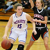(Brad Davis/The Register-Herald) Midland Trail's Meghan Gill drives to the basket as Summers County's Gavin Pivont defends Wednesday night in Hico.