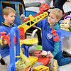 (Brad Davis/The Register-Herald) Young volunteers Carson (left), 7, and Mason Blankenship, 4, performed many roles during the day, but none as important as being unofficial toy testers during the Wyoming County Toy Fund event Sunday morning at Wyoming East High School.