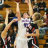 (Brad Davis/The Register-Herald) Midland Trail's Taylor Harrell drives to the basket as Summers County's Gavin Pivont, right, and Taylor Isaac defends Wednesday night in Hico.