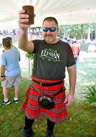 (Brad Davis/The Register-Herald) Crab Orchard resident Jeff Cox, dressed especially for the occasion in proper celtic attire, holds up a glass of Dobra Zupas' Irish Red as he takes in Daniel Vineyards' 2nd Annual Craft Beverage Festival Saturday afternoon in Crab Orchard.