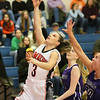 (Brad Davis/The Register-Herald) Summers County's Riley Richmond drives to the basket as River View's Demi Lester defends Saturday night in Hinton.