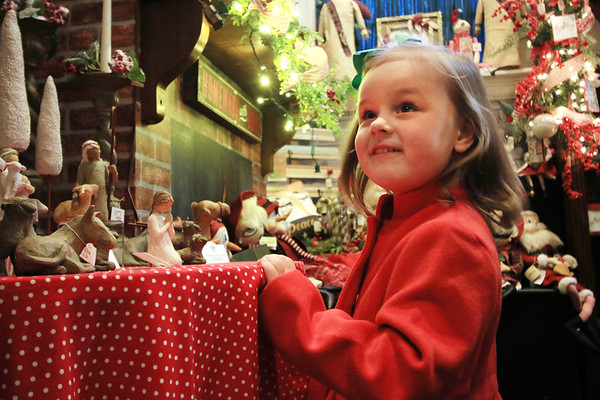Samia Persinger, 3, admires a nativitiy scene at the Greenbrier Christmas Shop at the Depot while shopping with her mother in White Sulphur Springs Monday. The family from Charleston came to spend a few nights at the Greenbrier Resort. (Jenny Harnish/The Register-Herald)